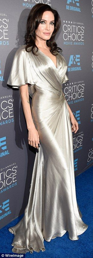 Classical: The actress's gown featured a trailing train, a crisscrossing bodice and gathered skirt