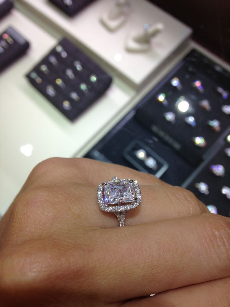 Henri Daussi raise elongated cushion cut 15 carat center stone with halo  Say yes to the
