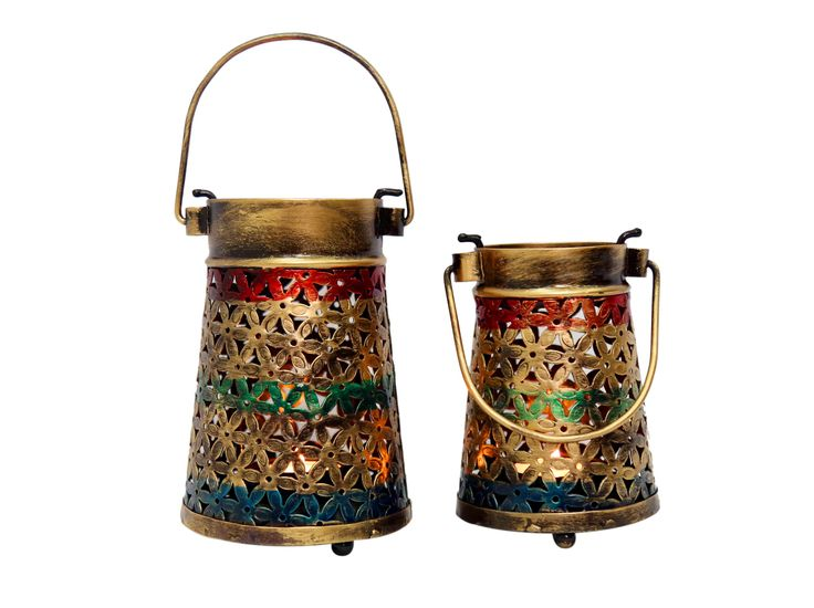 """""""This uniquely designed tea holder in jali is designed for dim lighting.The light from the tea light diffuses beautifully from the decorative cut work. This beautiful piece comes in a pair and will definitely catch the eyes of your guests because of its vibrant appeal and shimmering light effect.(There may be very MINOR VARIATIONS in color combinations and figure designs )"""
