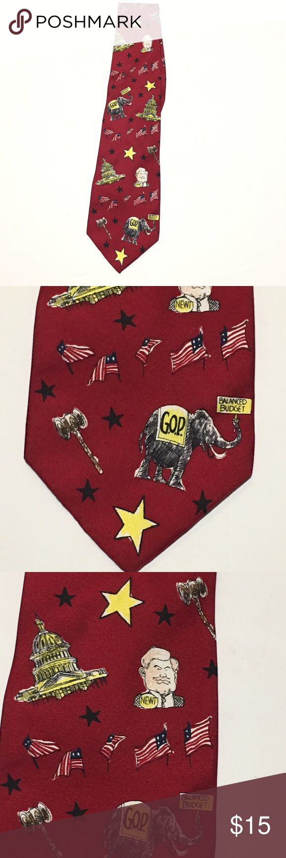 "Newt Gingrich GOP 100% Silk Tie By Mike Luckovich Red 100% silk tie designed by Mike Luckovich 1996. Features miscellaneous GOP motifs to include images of Newt Gingrich, elephant, gavel, flag, stars and the capital building. Made in the USA. Overall length 57"" (photo shown folded in half), front width 4"", back width - 1 3/8"". Mike Luckovich Accessories Ties"