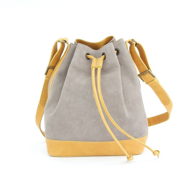 MARILIN bucket bag is made from smooth and soft suede leather with nubuck leather details and cotton interior lining.
