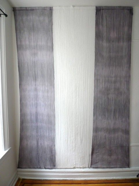fabric panels that attach to the wall with velcro! such genuis, as they can be taken down for landlords/changed for decor reason super easily and cheaply (approx $70 for a room)