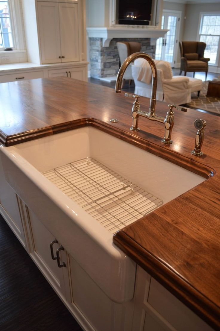 Distressed Walnut Countertop with a sink designed by Studio 76 Kitchens & Baths https://www.glumber.com/