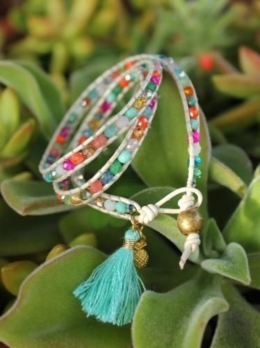 Triple wrap bracelet hand-sewn with silk to leather cord, in all the fun colors of a spring meadow; brass bead and loop closure. Handmade tassel and gold* pineapple charm add a fresh flair.