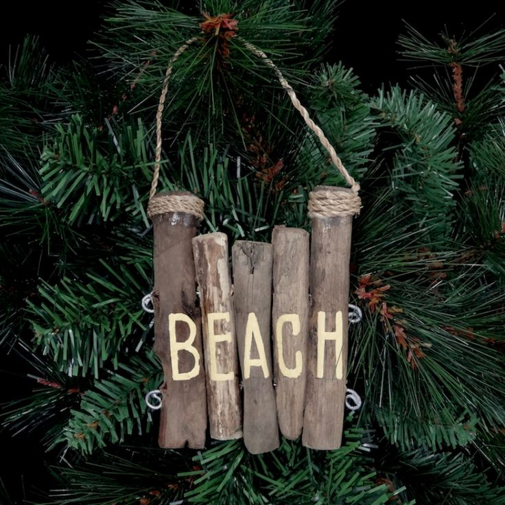 I'll Take the Beach Ornament from Charleston Jewelry and Gifts | If you prefer the beach over anywhere else, then the I'll Take the Beach Ornament is right up your alley, or right up your boardwalk! This driftwood beach ornament resembling pilings is so unique, you'll probably want to hang it somewhere in the house the rest of the year once Christmas has come and gone! Each ornament is slightly different because they're all one of a kind! charlestonjewelryandgifts.com