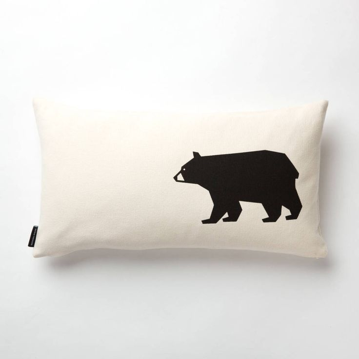 This pillow features the Bear printed in black Off-white pebble cotton with non-toxic print measuring 20 x11 with invisible zipper and 100% feather fill