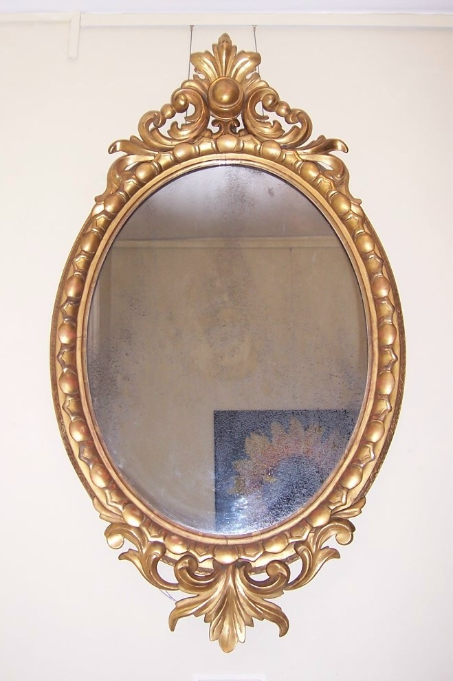 "FOR SALE! Carved Oval Giltwood Mirror, Mid 19th Century, retaining the original plate, 21"" x 38"" http://www.domani-devon.com/stock/mirrors/carved-oval-giltwood-mirror-mid-19th-century"