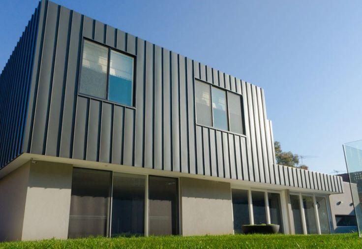 Camberwell Residence VIC Replaced timber facade cladding with aluminium cladding. Dark Grey Aluminium in Angle Standing Seam.