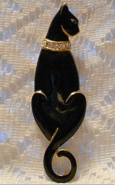 Vintage Black Enamel Cat Brooch by Trifari by ViksVintageJewelry, $24.99