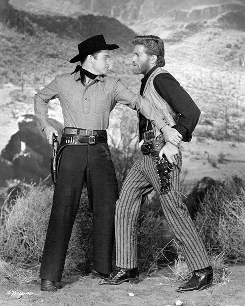 THE CIMARRON KID (1952) - Audie Murphy stands up to fellow outlaw Hugh O'Brian - Directed by Bud Boetticher - Universal-International Pictures - Publicity Still.