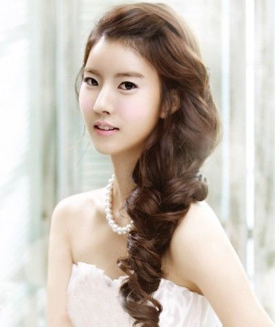 Ok, so this is a Korean inspired hairstyle, it's beautiful, will take the hair out of your face AND you can put it behind you instead of on the side like this.