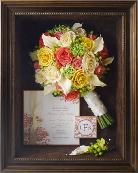 A beautiful display with preserved Wedding Flowers and an invitation www.freezeframeit.com