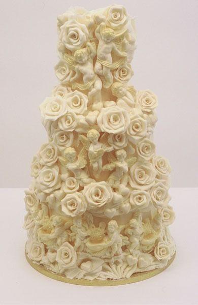 Google Image Result for http://www.vintagefolly.com/wp-content/uploads/2011/11/cherub-choccywoccydoodah-wedding-cake.jpg