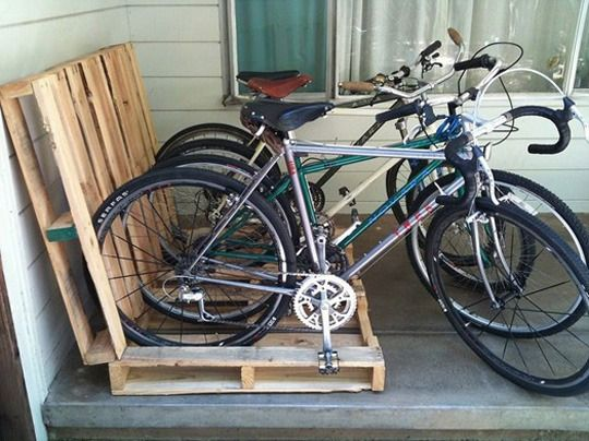 Bikes at our house could use an organized place to park when they aren't hanging in the garage during off season.   Possible pallet bike rack?
