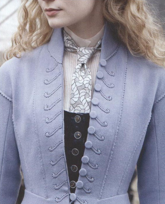 A close up pic of Alice's coat - Alice in Wonderland. Designed by Colleen Atwood.