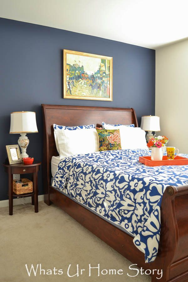 Navy and Coral bedroom decor - Paint color = Sherwin Williams Naval -www.whatsurhomestory.com