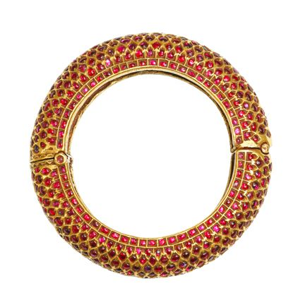An Antique Gold and Ruby Bangle  Deccan, Mysore  19th Century.    A magnificent antique bangle inset with matched Burmese rubies set using the kundan technique.