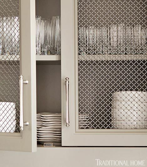Stainless steel mesh cabinet faces show off dishware.: Steel Mesh, Wire Cabinets, Mesh Cabinets, Cabinets Faces, Cabinets Handles, Kitchens Cabinets, Traditional Homes, Cabinets Doors, Stainless Steel