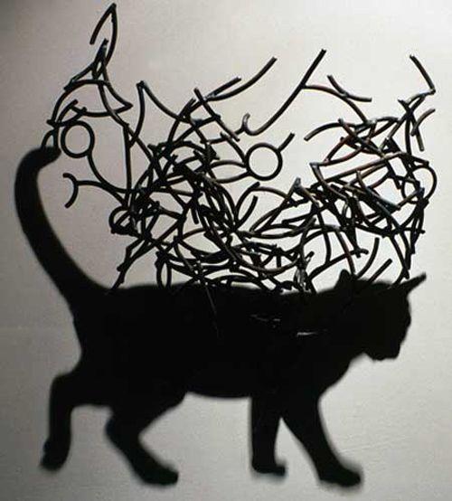 Shadow art - various pieces by Kumi Yamashita, Tim Noble & Sue Webster, Shigeo Fukuda, and Larry Kagan.