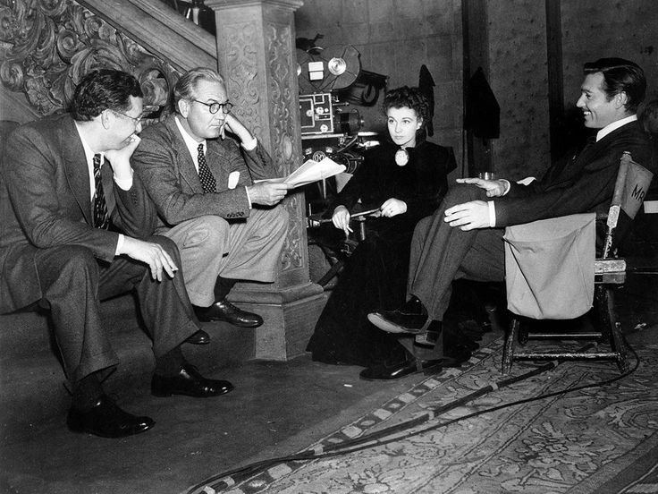 Producer David O Selznick, director Victor Fleming, Vivien Leigh as Scarlett O'Hara, and Clark Gable as Rhett Butler, on the set for final scene of Gone with the Wind (1939).
