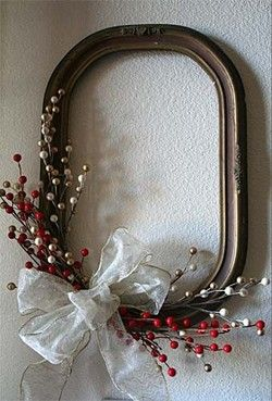 Berry and Ribbon Decor. Use an empty frame and add a little fake cranberry and glitter to spruce it up.