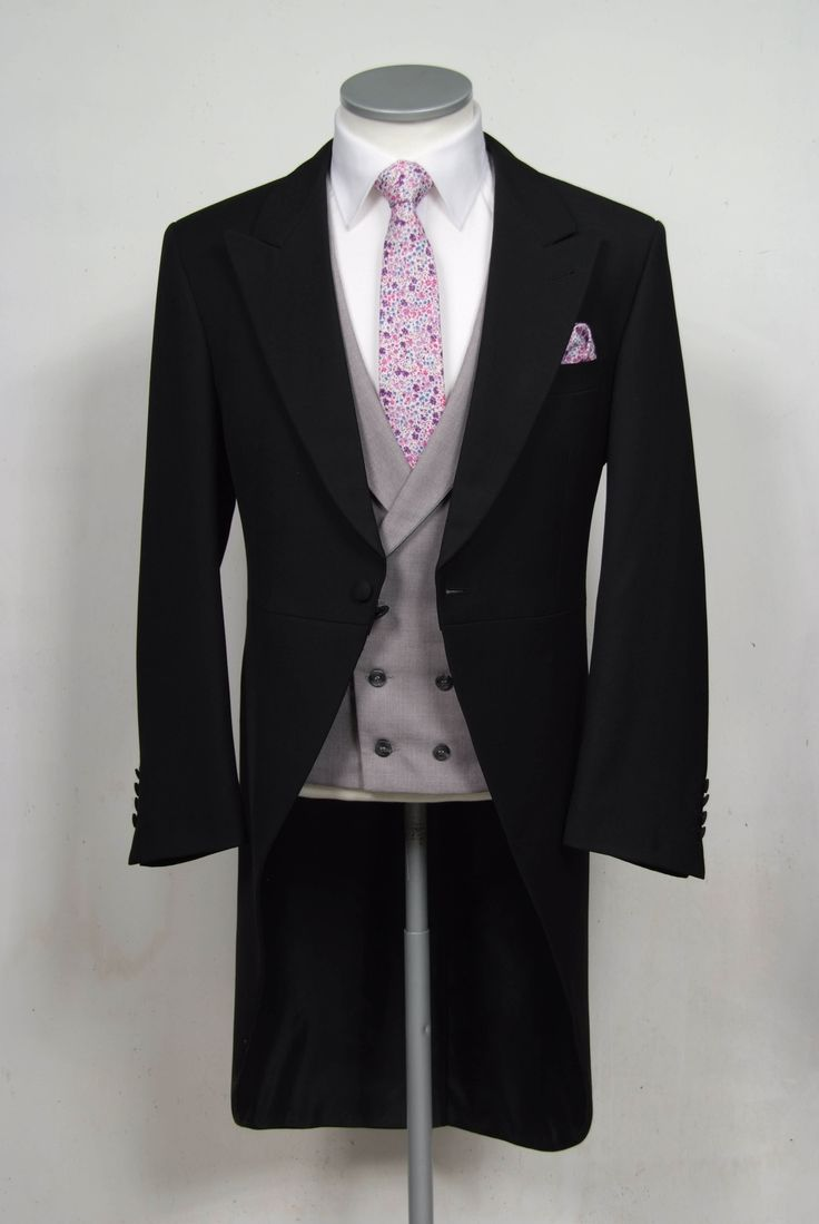 "grooms wedding tails suit black slim fit in light weight wool with double breasted waistcoat. Mens sizes from 32"" chest upward and include extra short, short, regular, long and extra long fittings. Boys sizes from 20"" to 34"" chest. Complete outfit includes jacket, skinny trousers, hire or matching waistcoat, brand new traditional or French wing slim fit shirt in white or ivory, tie or cravat, braces and cufflinks. £195.00 to hire #groom #wedding #suit #hire #suithire #waistcoat #black #groom"