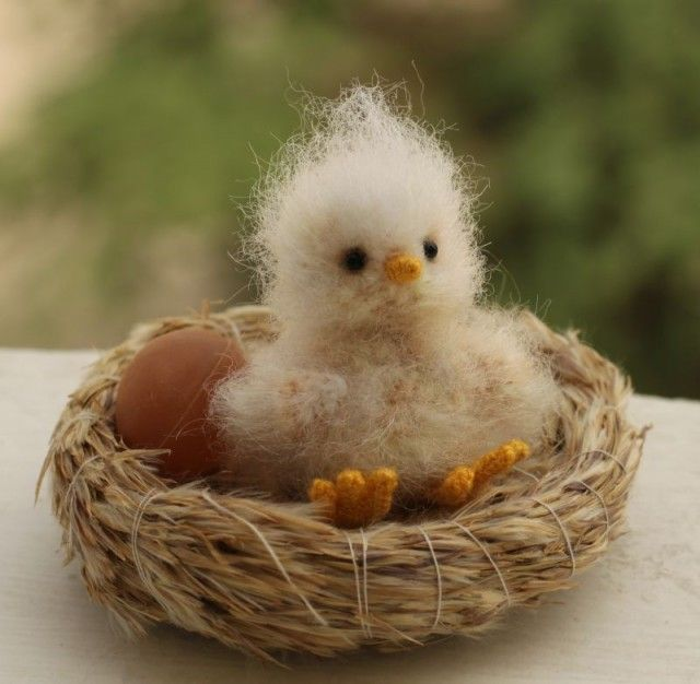 A very fuzzy baby bird in a little straw nest would look sweet on your table as a place name holder or on an Easter egg tree.