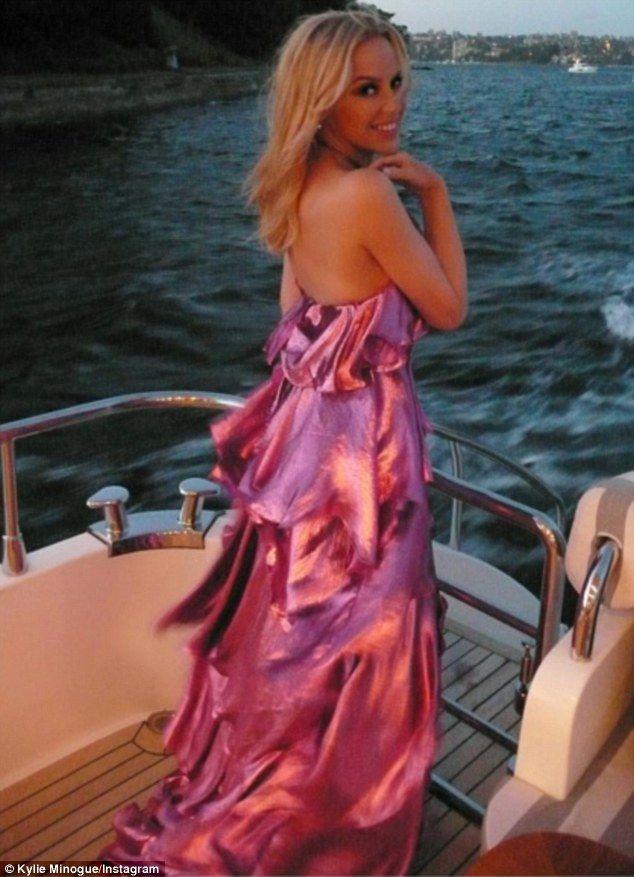 Kylie spinning around in gorgeous metallic dress