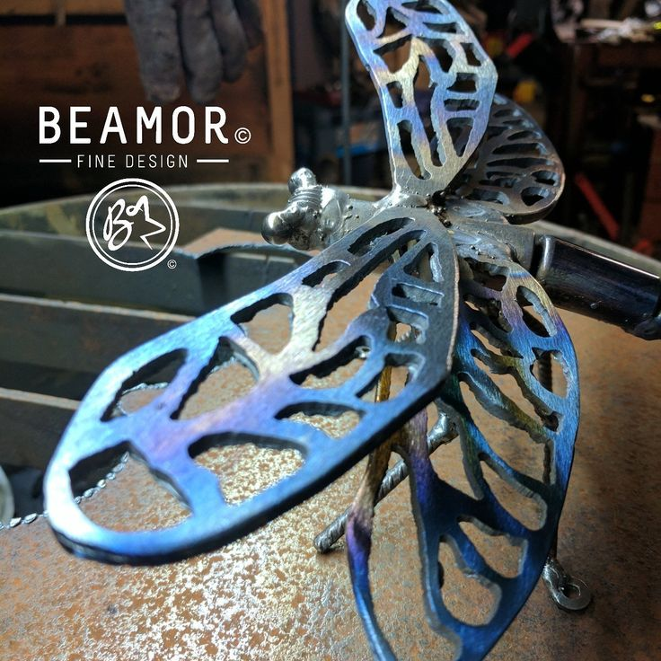 Love the iridescent effect on the wings. Hand plasma cut Dragonfly wings and body from recycled materials. Available in our Etsy Store. #metalart #plasmacutting #upcycle #dragonfly #gardenart #wallart