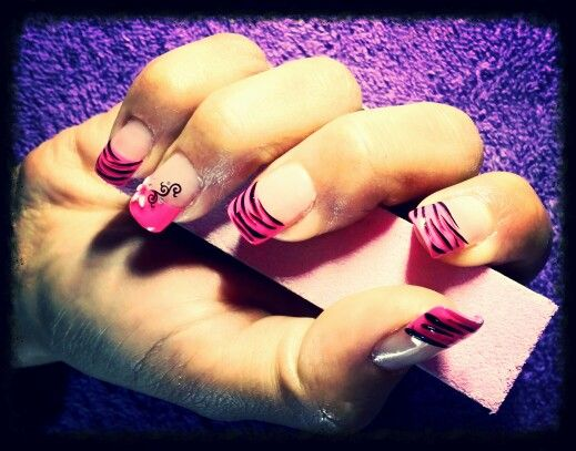 Pink and black nails with flower and stripes