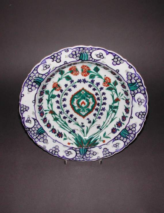Maker: Unknown; potter Category: fritware (stonepaste) Name(s): dish Islamic pottery; category Iznik; category Date: circa 1570 — circa 1590 School/Style: Ottoman Period: late 16th Century