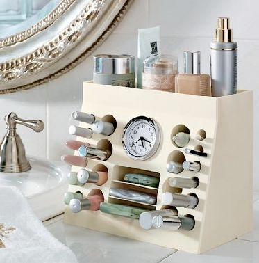 makeup organizer-pvc pipes in short sections, mounted in a block of florist foam, out cover made from choice of foam board, thin plywood, or masonite. Clock either from mail order, or GW (many remove quite easily from original case).