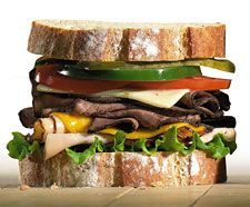"the ""Dagwood"" Sandwich - Originated in the comic strips in the 1930s after   Dagwood Bumstead.  Usually a huge  pile of various leftovers. precariously arranged between two slices of bread. Dagwood became know for his huge sandwiches he created on evening forays to the refrigerator."