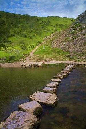 Stepping stones across the river Dove, Dovedale, Derbyshire