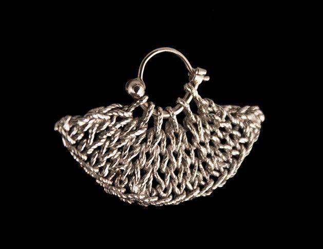Earrings by Ashley Stevens.