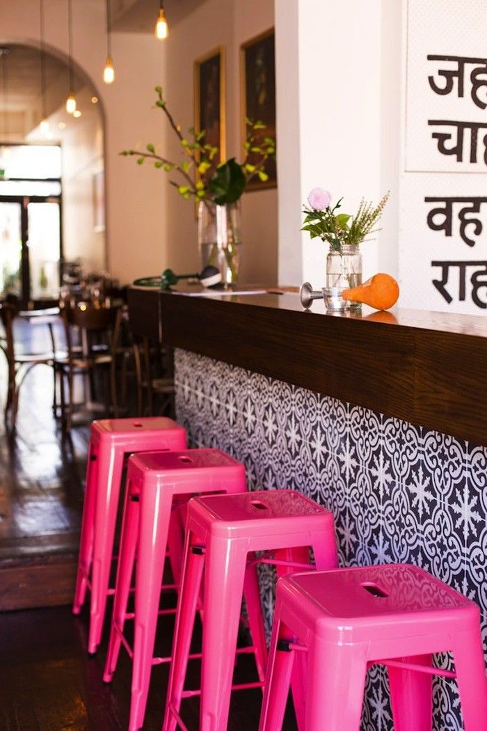 Hot pink stools and the best bar tile!