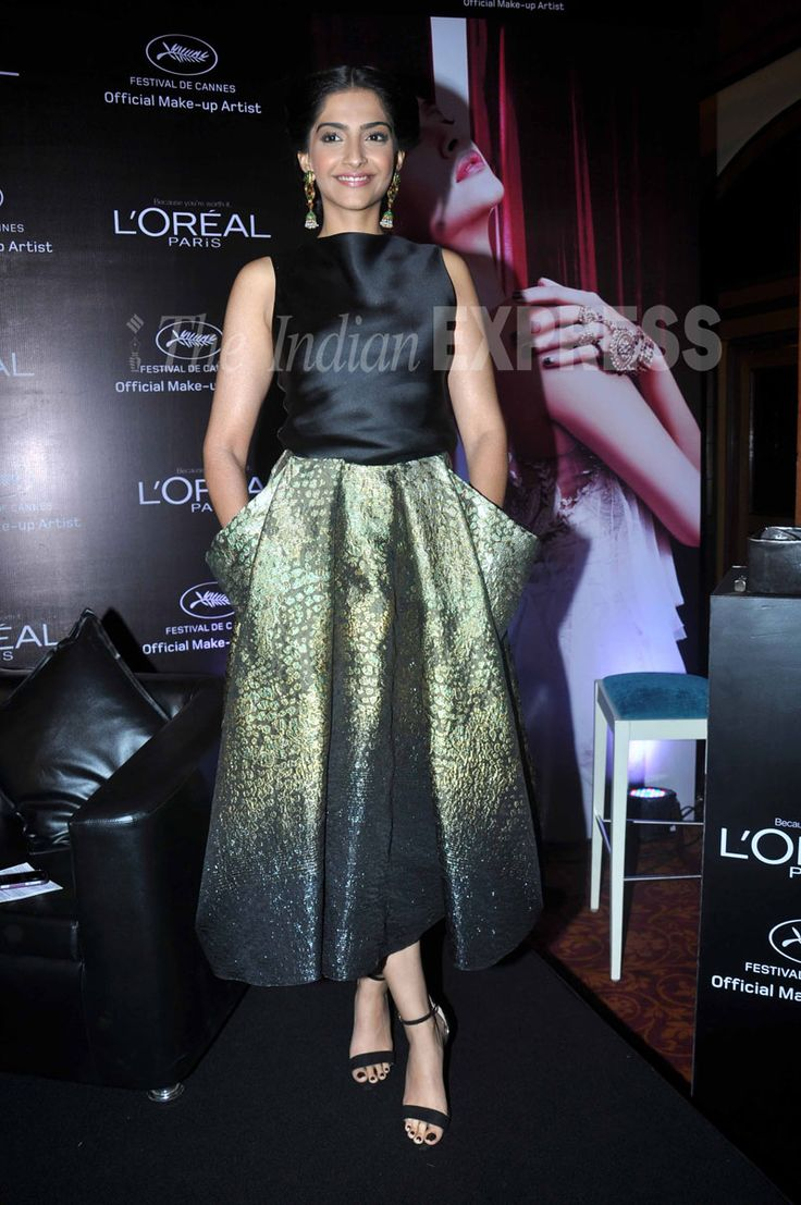 Sonam looks looks radiant in an Armani Prive dress.