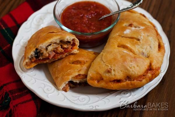 """Calzone,which means """"stuffed pants"""" in Italian,is like a little pizza sandwich. These Calzones stuffed with pepperoni, sausage and Canadian bacon are for meat lovers."""