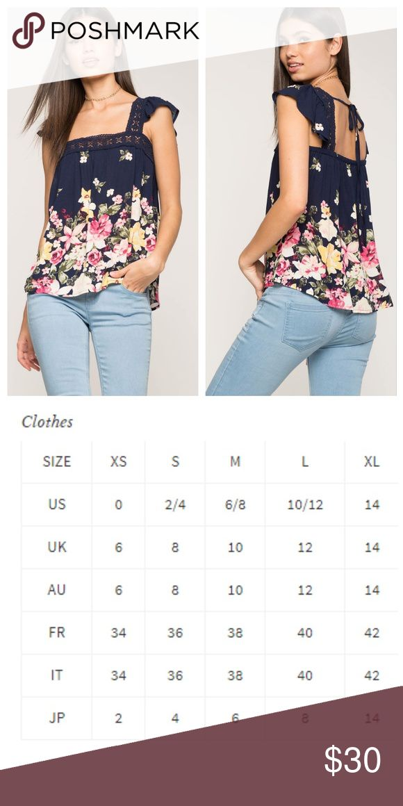 """Pretty Floral Print Border Top Blouse features pretty floral print, square neck with crochet trim and short ruffle sleeves. Cutout back with tie closure. Scoop hem. Stretch material. Measure approx. 21"""" long. 100% polyester. Hand wash cold Tops Blouses"""