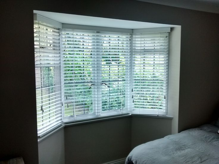 Wood venetian blinds  installed to a bay window in Haywards Heath, Sussex.  Wood venetians with strings were used to keep the look simple against the traditional lead windows.