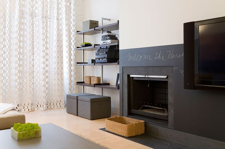 Like the chalkboard around the fireplace.  From Laura Bonn Design