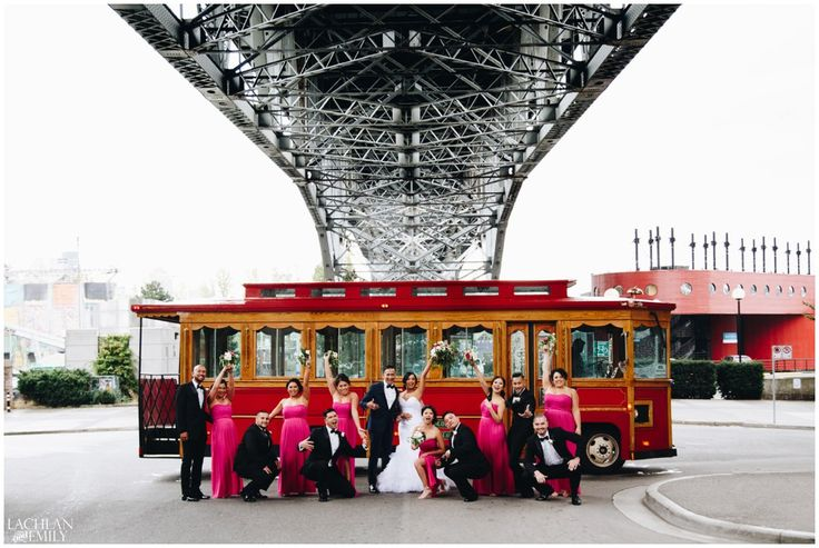 "Rain On Your Wedding Day Tip #2: Always have a plan ""B"". ⠀ Especially if you have a large bridal party, having a secondary covered location for your group shots is much more efficient than accommodating 14+ people with umbrellas. For this particular wedding, we found that under the Granville Street Bridge gave us the rain cover we needed while still letting in the stunning soft light of the day."