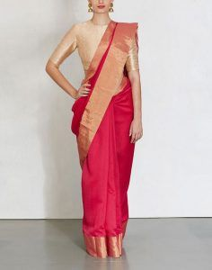 Exclusive Red silk saree with gold blouse