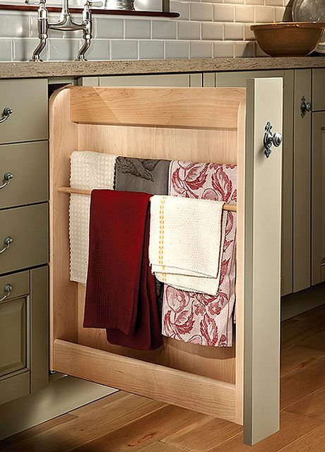hidden storage. pull out drawer for towel rack in kitchen.