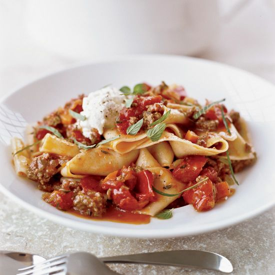 Pappardelle with Lamb Ragu | Andrew Carmellini serves fresh pappardelle with a ragu of house-ground lamb shoulder cooked in lamb stock. He finishes the dish with fresh ricotta and chopped mint.