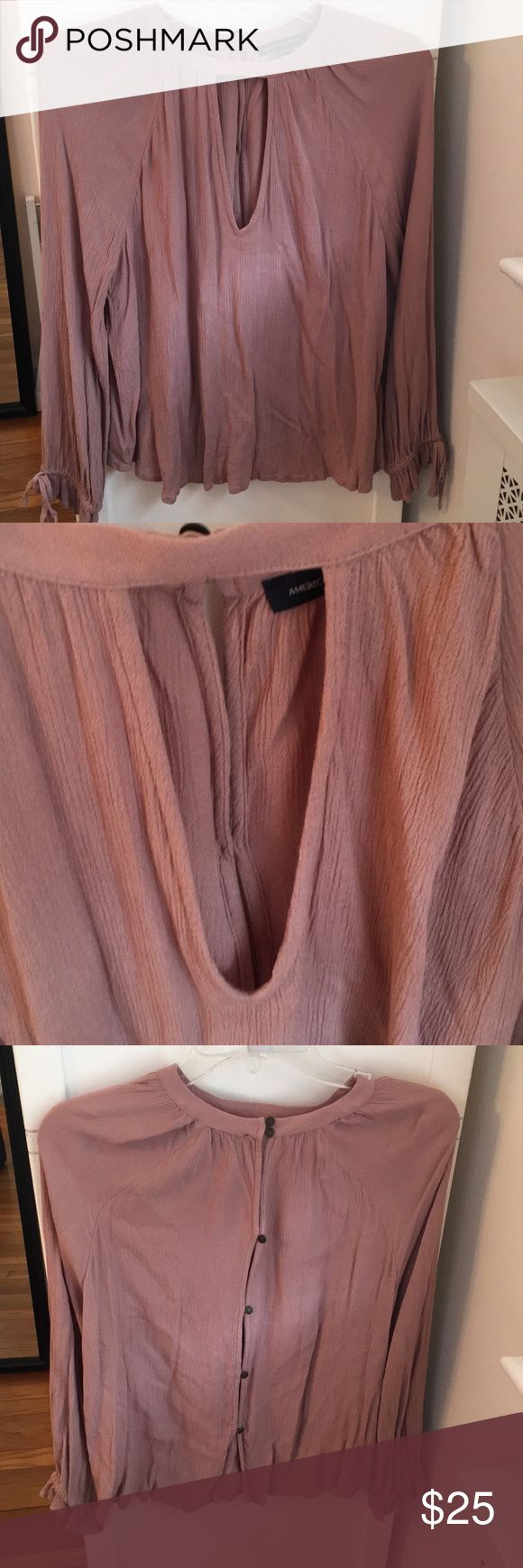 American Eagle flowy shirt Dusty rose color with tight ends for the sleeves all buttons on the back makes it super flowy and light weight worn twice with a key hole neck line detail in the front. Small Pettit but I'm 5'6 and it fit me perfect. Lays right on top of the jeans. American Eagle Outfitters Tops