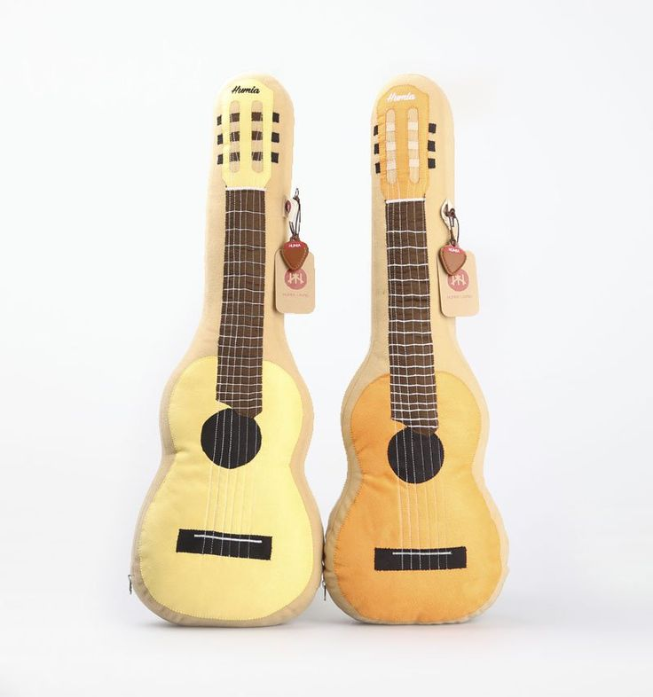 Guitalele Cushion Yellow and Orange by  Humia Living. A perfect and adorable cushion to decorate your room feature 2 cushion in guitar shaped. A set of cushion in yellow and orange color and each of cushion has size dimension: 60cm x 22cm x 14cm. @zocko #buyit #stuff #pillows  http://www.zocko.com/z/JKBLd