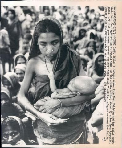 A Refugee Woman from East Pakistan and her Child await their turn for Registration at Sidhai Camp, on the Indian border, about 15 miles from Agartala - 1971