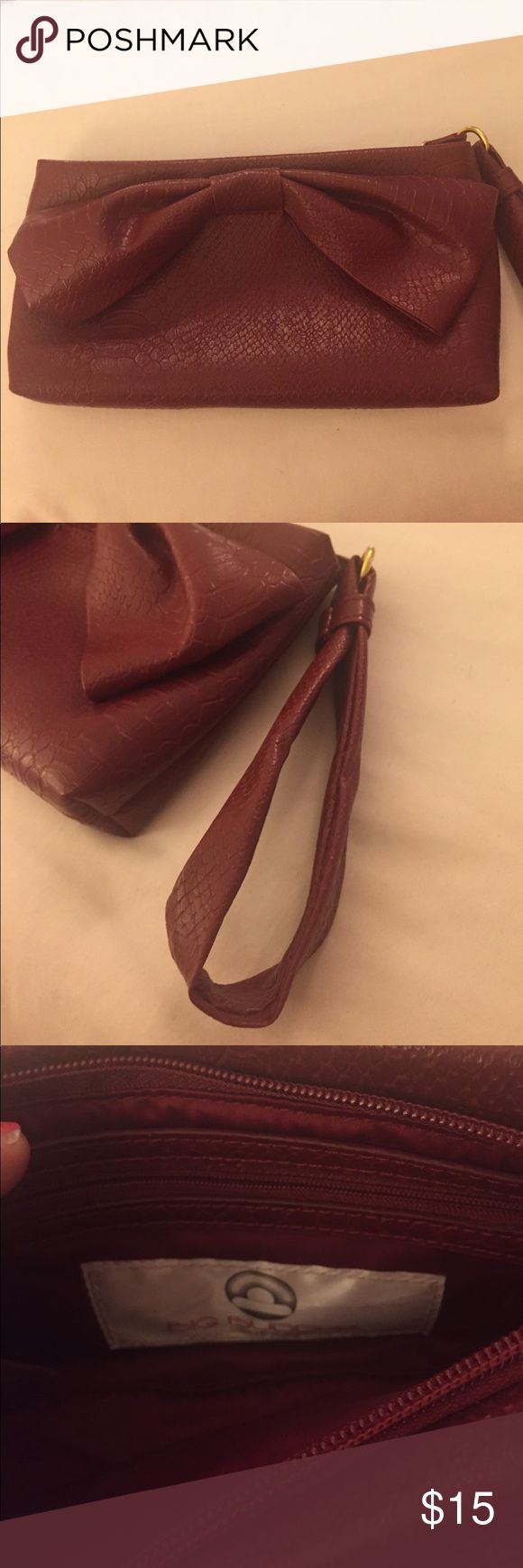 Large Bow Wristlet Large maroon Big Buddha brand Wristlet. 9x5 in size. Great condition. Big Buddha Bags Clutches & Wristlets