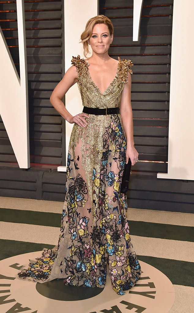 Elizabeth Banks from 2017 Vanity Fair Oscars After-Party  The actresssported pitch perfect style in a gold belted gown with floral embroidery.